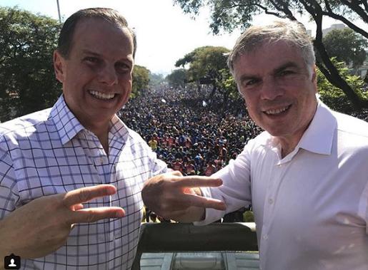 Resultado de imagem para João Doria marcha ao lado de Flávio Rocha